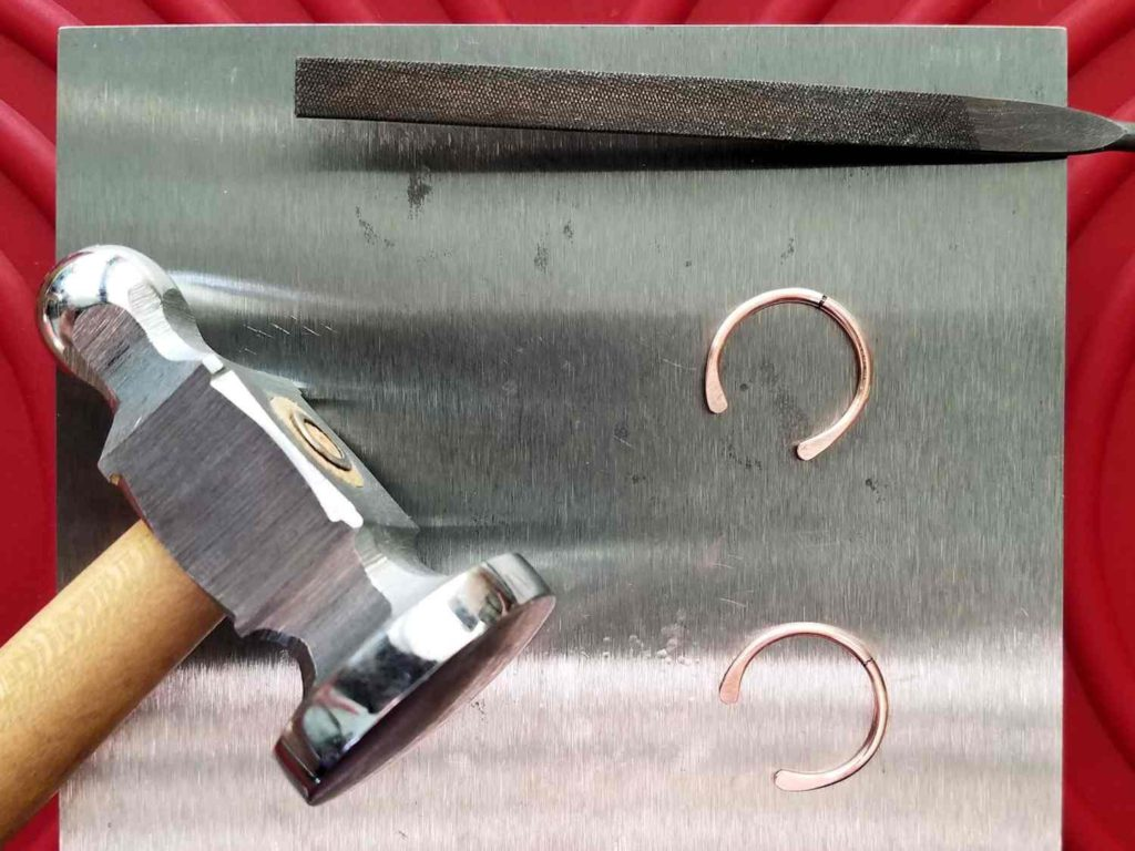 Step 3 - Paddle the ends of your two 16ga core wires using your bench block and chasing hammer, as shown.