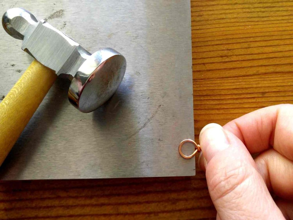 Step 6 - Use a chasing hammer and bench block to flatten both loops of your Infinity Loop component.