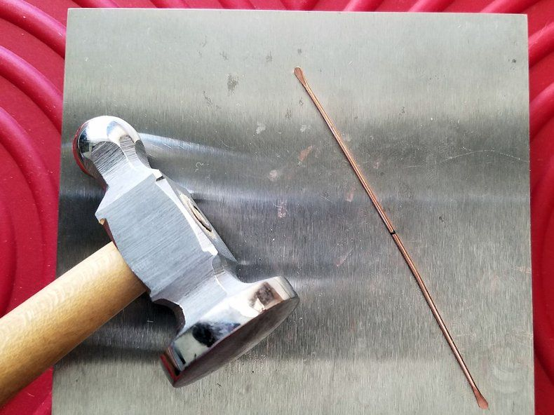Core Wires Step 6 - Use your chasing hammer and bench block to paddle the ends of all three 18ga wires, as shown.