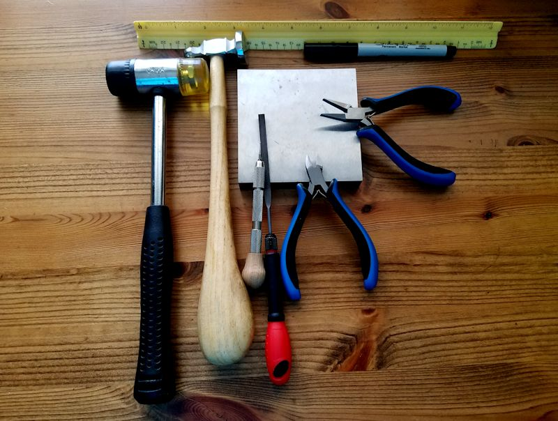 The basic tools needed to make the easy stick earrings are pictured here and itemized below.