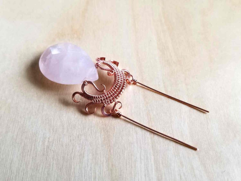 Preparing to connect the necklace chain to a finished Lyonesse Pendant with two beaded wrapped loop connectors