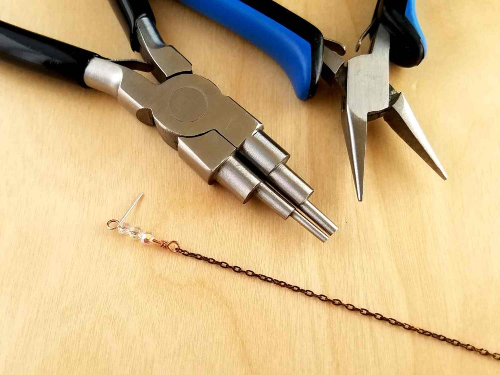 Adding a beaded wrapped loop connector to the end of a piece of chain using stepped bail-making pliers and chain nose pliers
