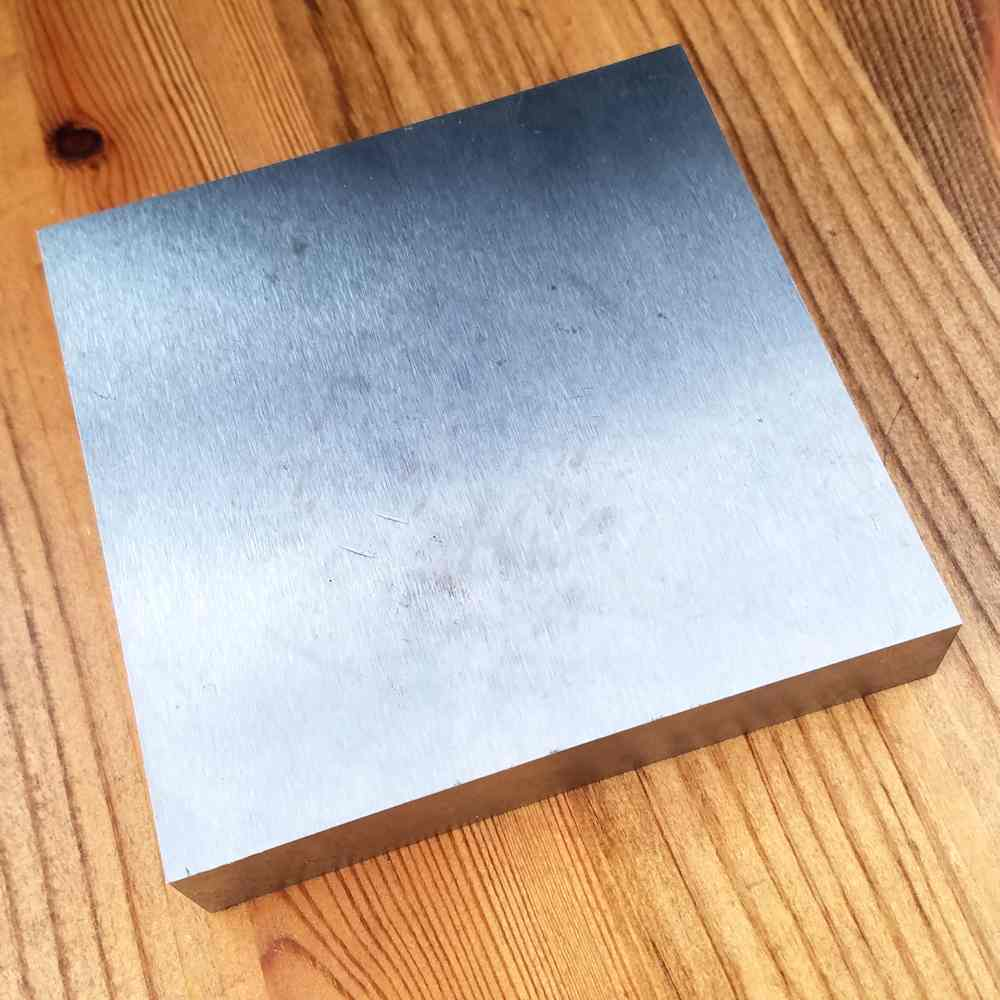 This is a standard 4-inch hardened steel bench block. Although this one doesn't have the sound deadening benefit of a rubber base, it does have a large work surface, which is very useful for wire work.