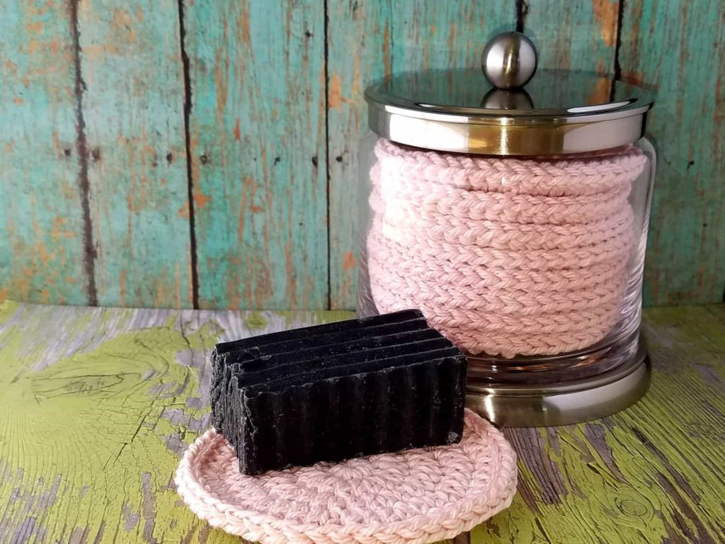 Door 44 Studios crochet face scrubbies in pretty glass and brushed nickel jar. Also featuring organic lavender facial charcoal soap by Rocky Mountain Soap Market