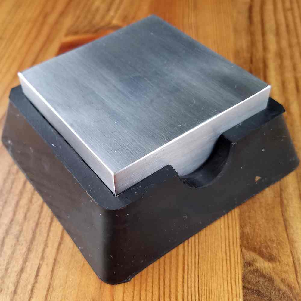 A steel bench block with a rubber base, such as the one pictured here, is very useful if you want to minimize noise. The rubber base absorbs both shock and sound, making this one of the quietest bench blocks I've ever used.