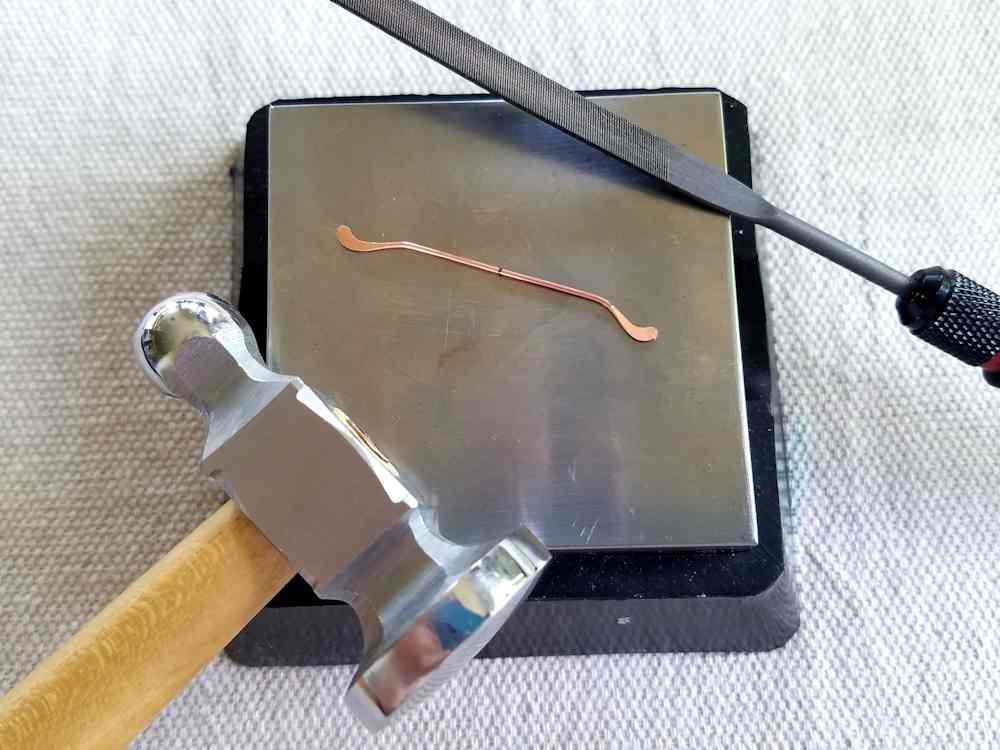 Delicate Bar Pendant, Step 8: Work harden the ends of Wire 2 to lock the curves into place