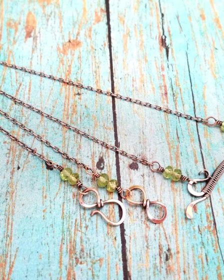 The Delicate Bar Pendant is a quick and easy wire weaving tutorial suitable for beginners. This pretty little bar pendant is very versatile as it can be used as a component in more complex pieces or it can stand on its own. It also makes a great birthstone necklace when accented with crystal or gemstone beads. The necklace pictured here is accented with genuine Peridot beads, wich work beautifully with the copper wire use to make the pendant.