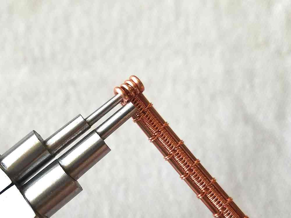 Step 32 - Loop the ends of the woven core wires using the 2mm step on your stepped bail-making pliers.