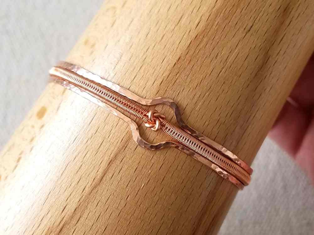 Form the bracelet into its finished shape. Use of a bracelet mandrel, as shown, is optional.