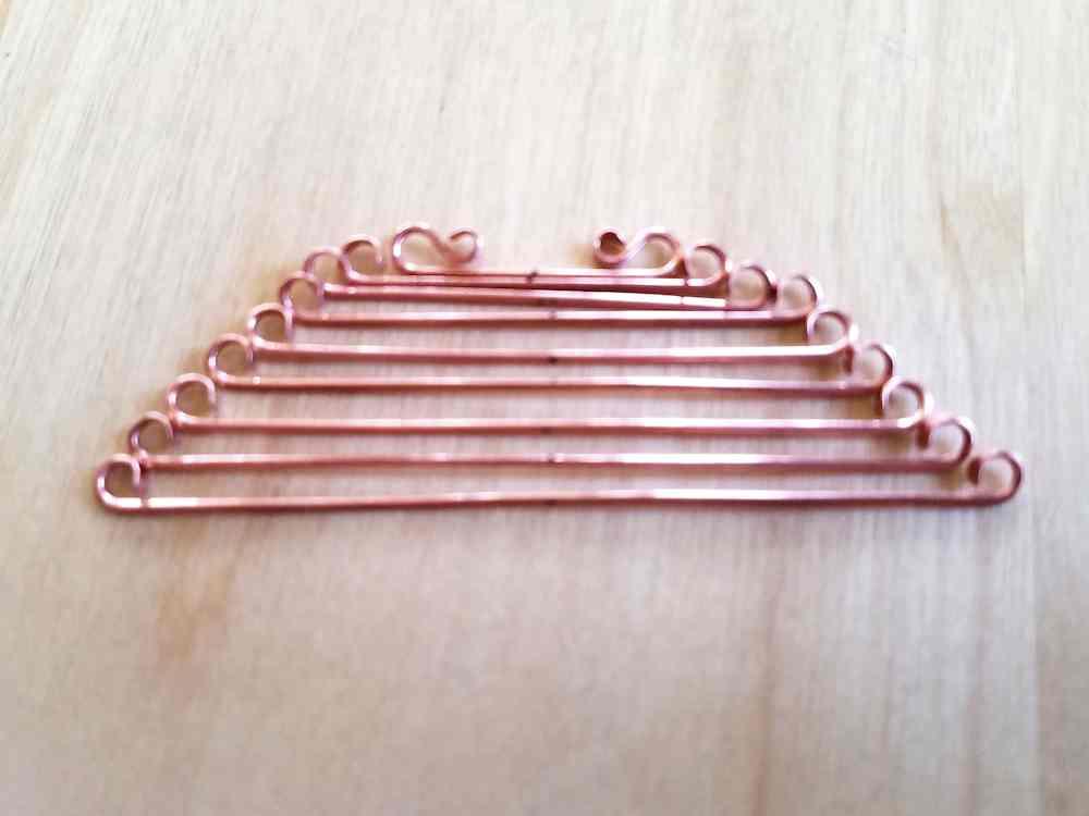 Door 44 Studios Ancestor Pendant Tutorial: Step 8, curl the ends of wires 4 through 9