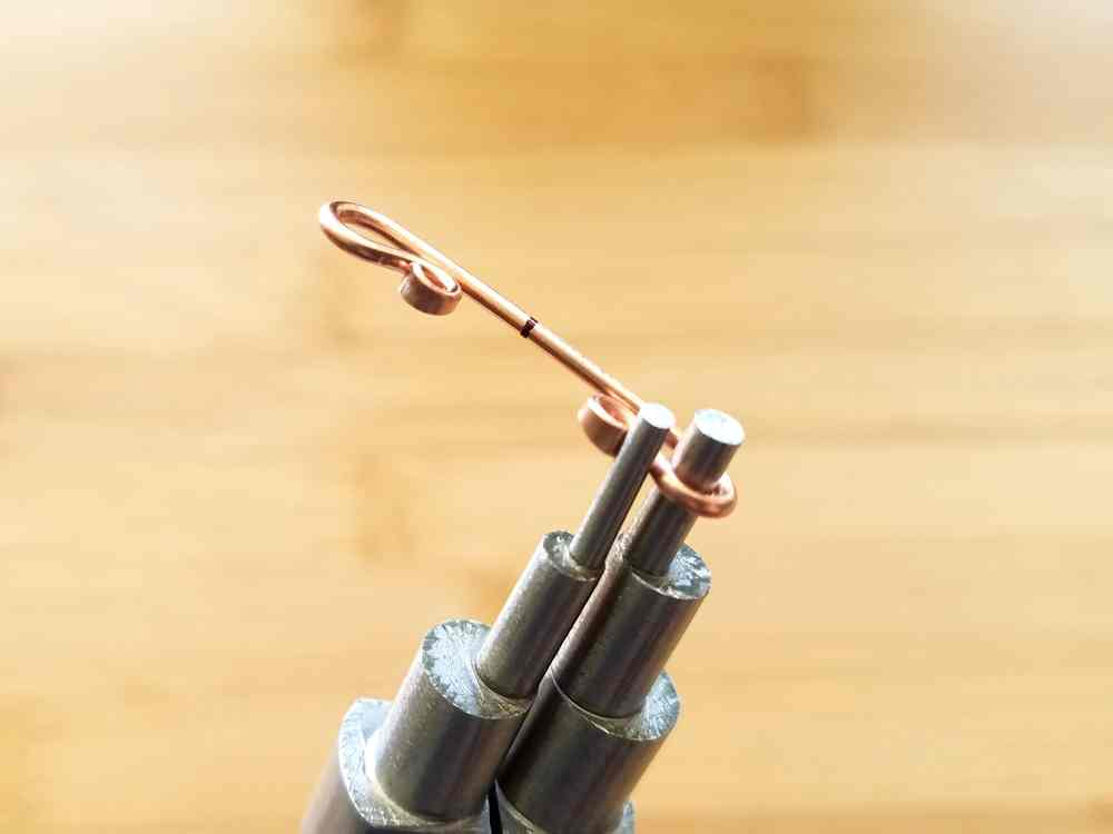 Step 8 - Loop the ends of the bail wire using your stepped bail-making pliers.