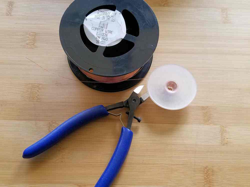 Step 12 - Prepare your weaving wire by winding several feet of wire onto a plastic bobbin.
