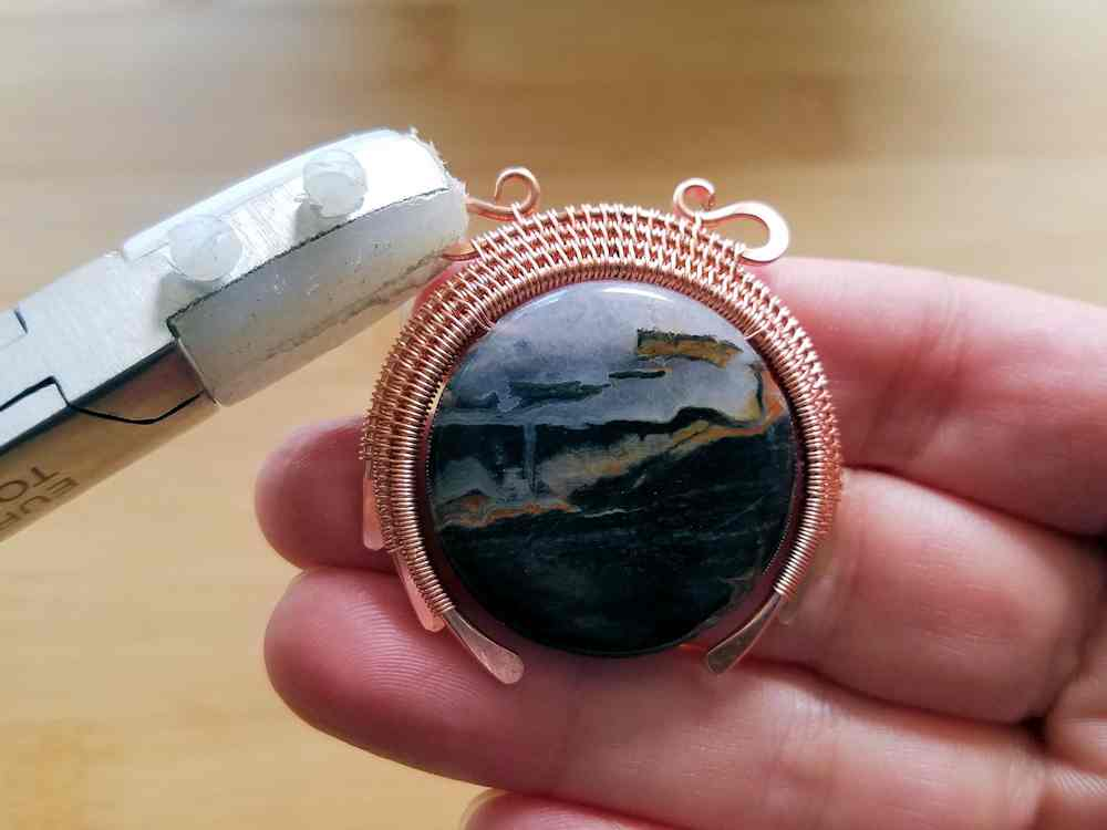 Step 21 - Sculpt the bead frame into a convex shape and position the loops on the bail wire.