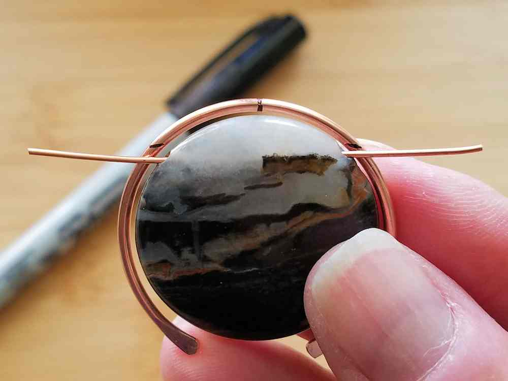 Step 13 - Feed a scrap piece of wire through your focal bead and use the wire to determine where the bead will be attached to Wire 1.