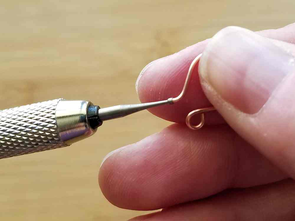A cup burr is a special tool designed to round off the edges of ear wires. This tool is optional. A needle file works just as well.