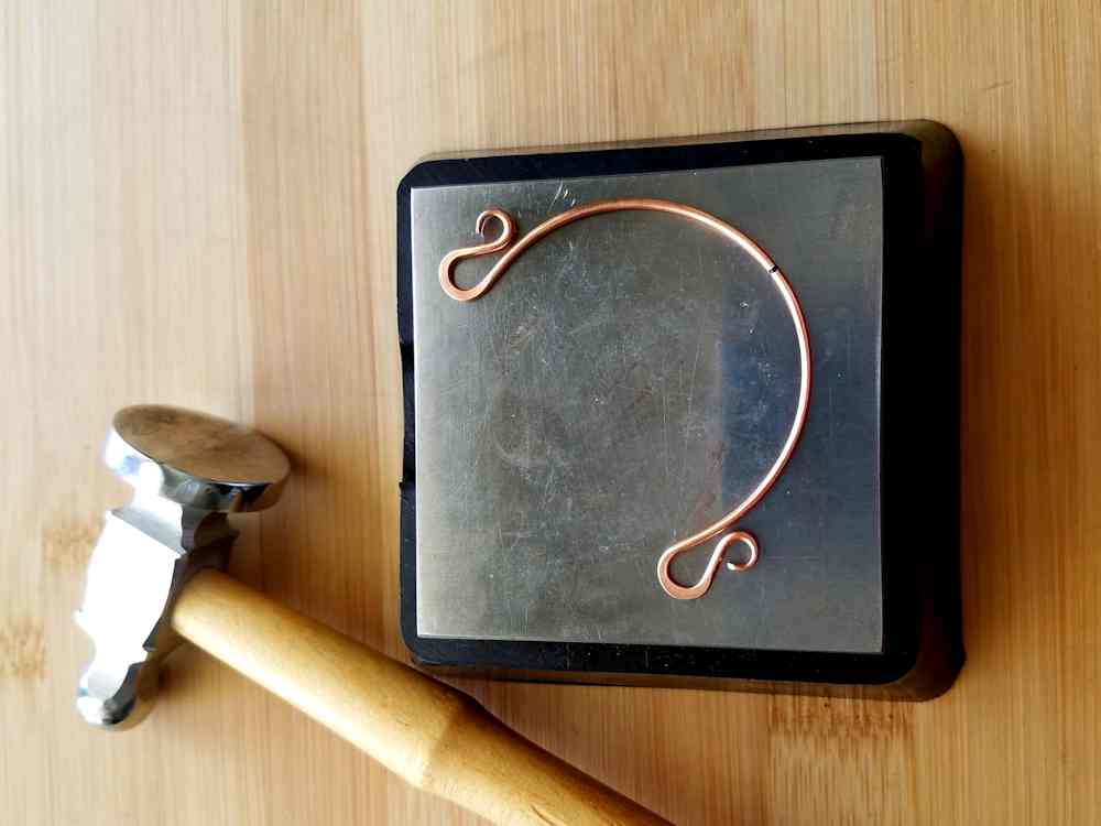 Step 9 - Use a bench block and chasing hammer to flatten the curved ends of Wire 2. Be careful to avoid marring the small curls on that wire with the chasing hammer.