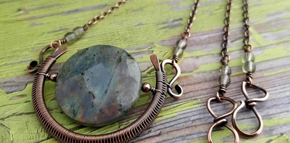 The Egyptian Sun Pendant featuring a faceted Labradorite focal bead and using my alternate method for securely suspending a focal bead within a woven wire frame.