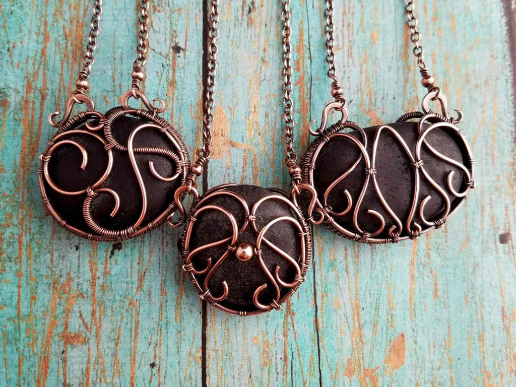 Door 44 Studios - Private Commission: Three bespoke necklaces made with Icelandic beach pebbles, provided by customer and wrapped in copper by Wendi Reamy.