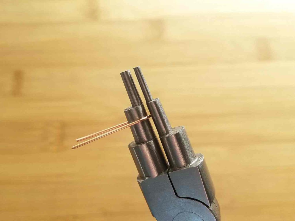 Step 2 - Form the first core wire into an elongated U shape, using the 6mm step on your bail-making pliers, as shown.