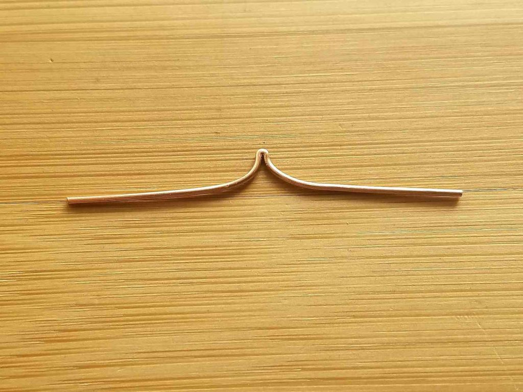 Step 7 - When the fold is opened, your wire should be relatively straight with a sharp peak in the center, as shown.