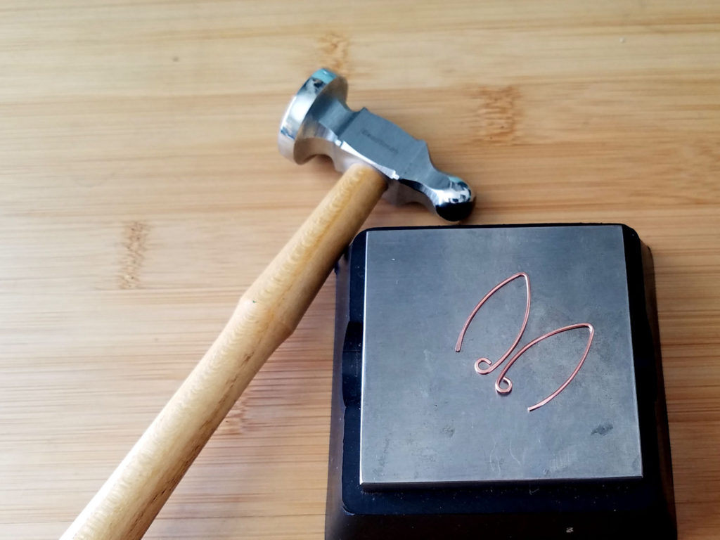Step 11 - If desired, use your chasing hammer and bench block to slightly flatten the ends and the points of your Marquis ear wires, as shown.