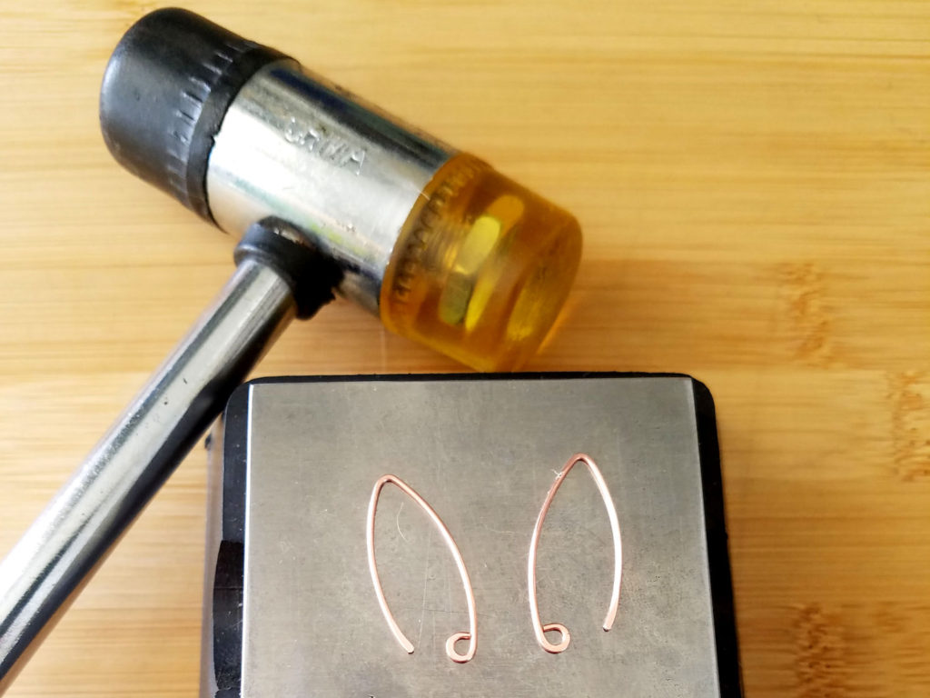 Step 12 - Work harden your Marquis ear wires with your bench block and nylon or rawhide mallet, as shown.