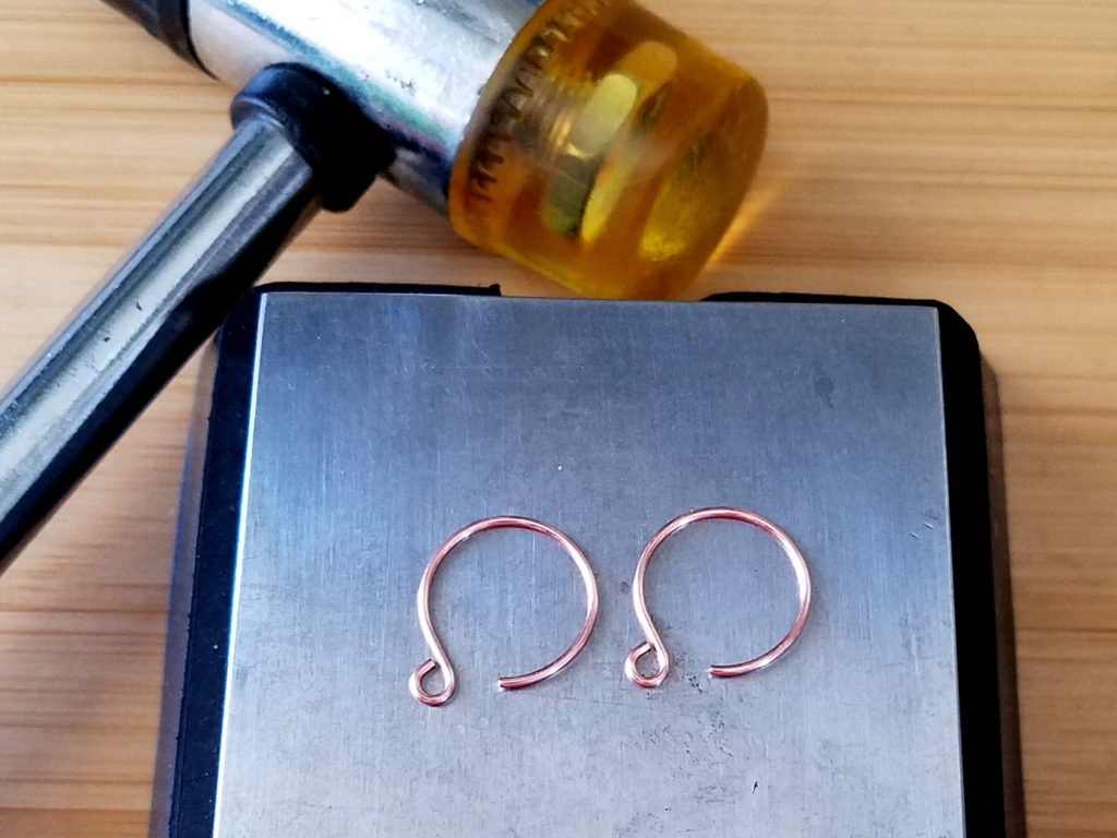 Step 18 - Use a soft mallet and bench block to work harden the finished ear wires, as shown.