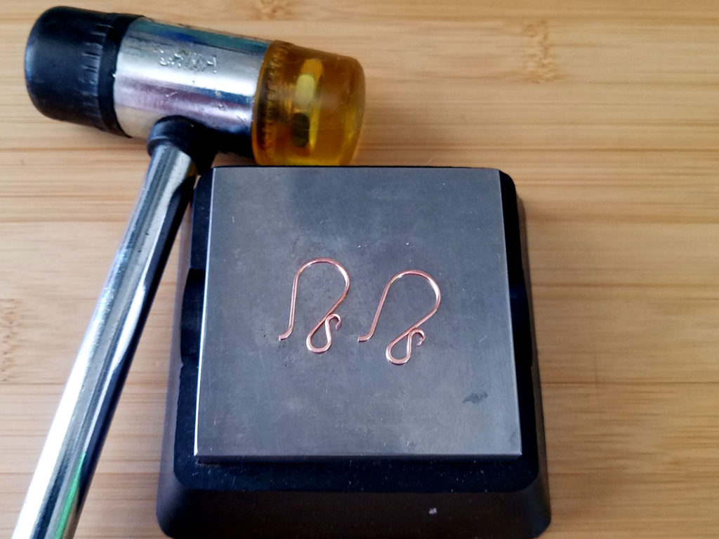 Step 16 - Use a soft mallet and bench block to harden the wires, as shown.