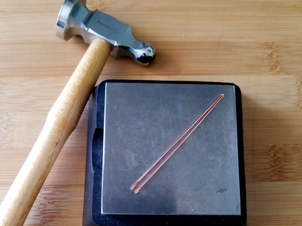 Step 5 - Paddle the cut ends of the folded wire with a chasing hammer and bench block, as shown.