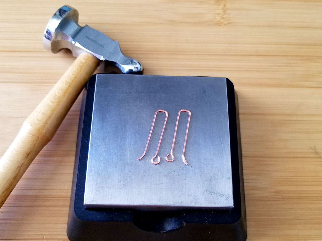 Step 16 - If desired, use a chasing hammer and bench block to slightly flatten the points of your ear wires, as shown.