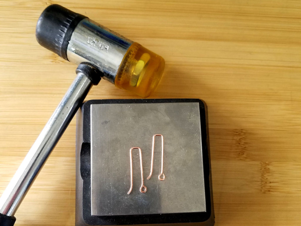 Step 19 - Use a soft mallet and bench block to work harden the ear wires, as shown.