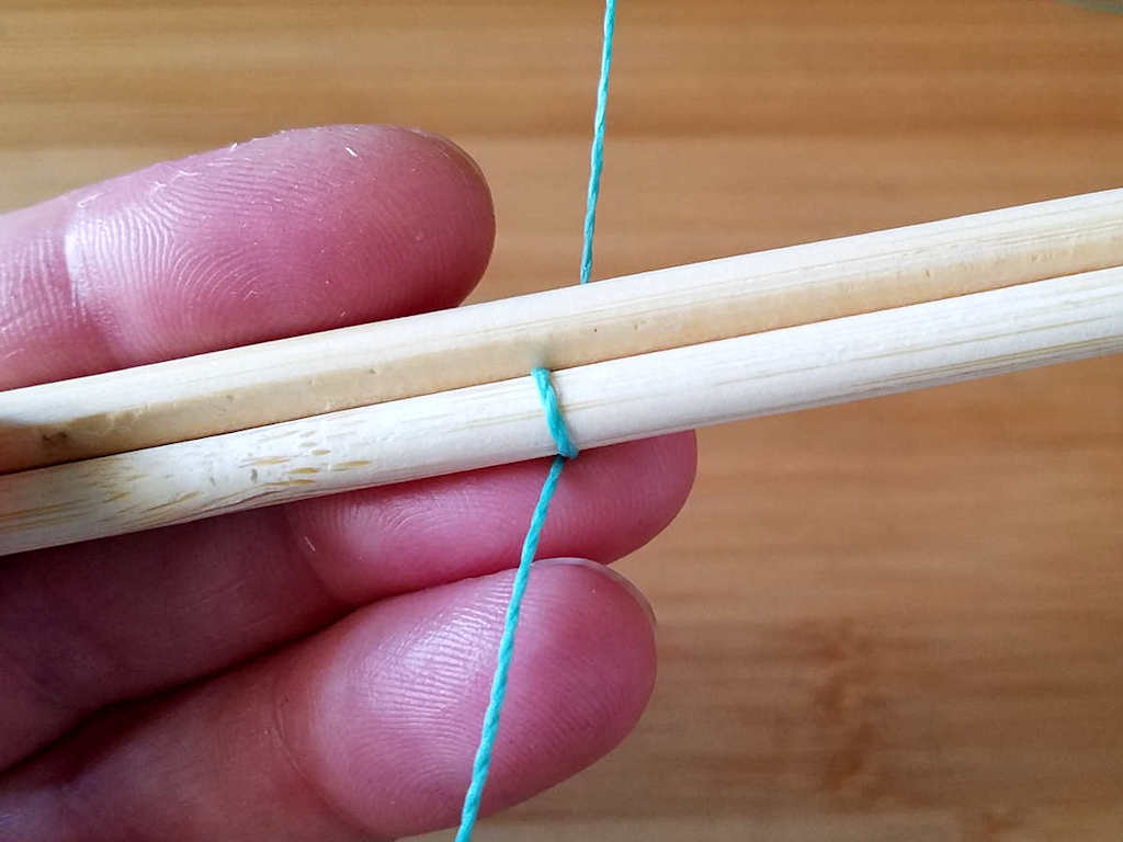 Step 3 - Place your second core wire above the first and in front of the weaving wire, as shown.