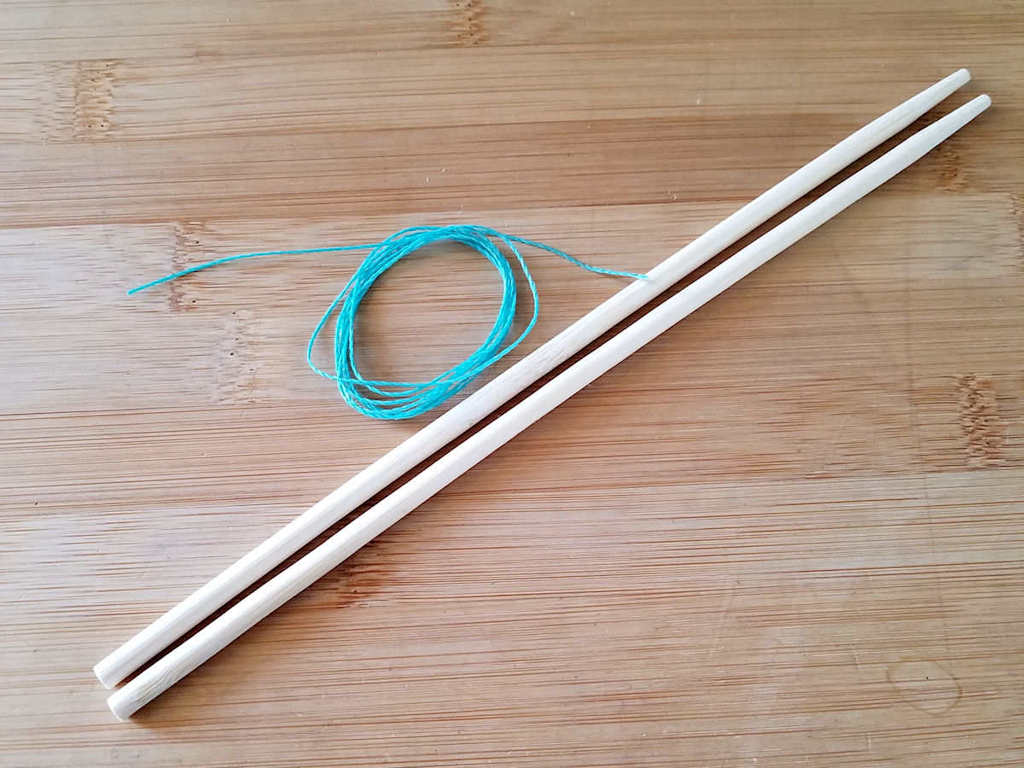I substituted wood chopsticks for the core wires and waxed jewelry cord in a contrasting color for the weaving wire to make this tutorial easier to follow. Those materials are pictured here.