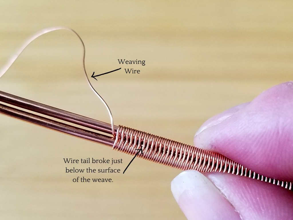 This image shows the splice after breaking the two weaving wire tails. The only visible indication that the wire was spliced is that the broken point of the tail can just be seen under magnification, as shown. The weave appears seamless with the naked eye.