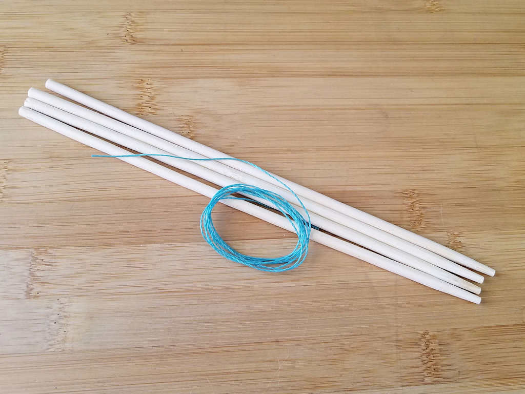 I'm using simple wood chopsticks and waxed jewelry cord in a contrasting color to demonstrate the Modified Soumak increase and decrease techniques. Those materials are shown in this image.
