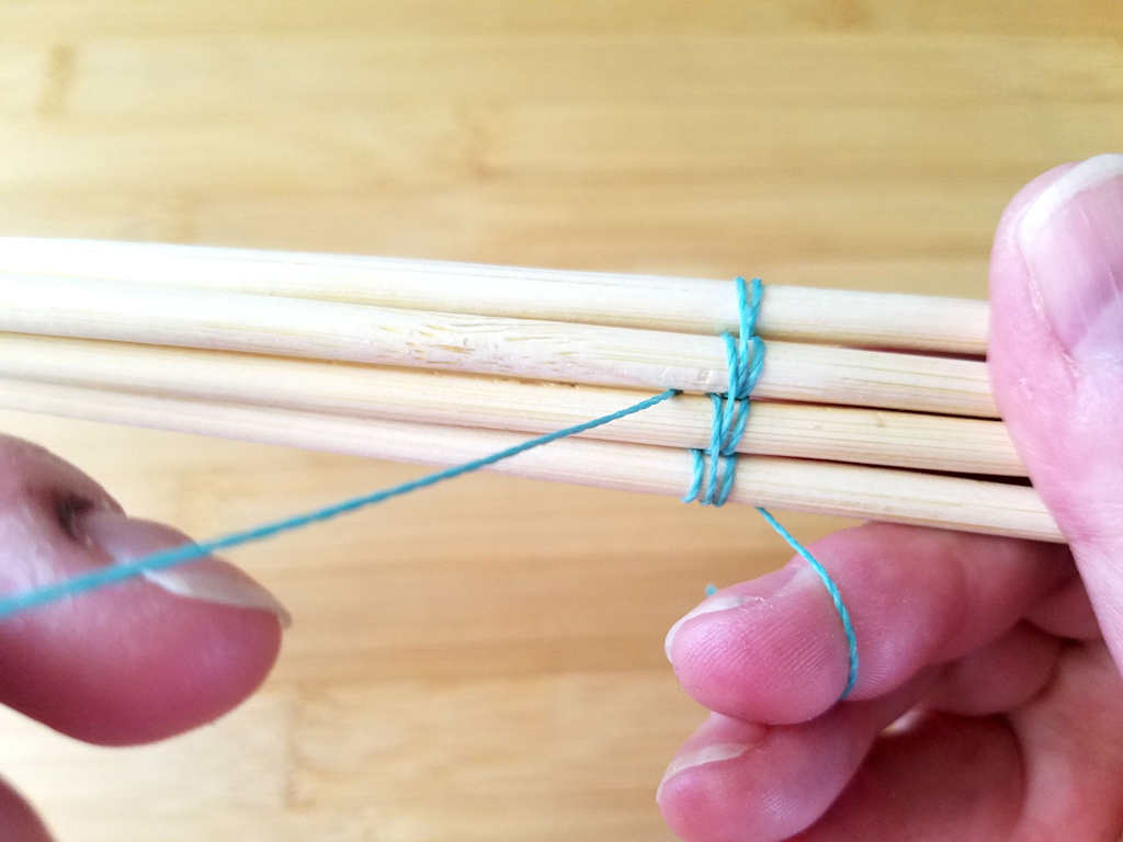 We're now working the second upward pass by wrapping around wire 1 and then bringing the wire to the front of the weave between wires 2 and 3, as shown.
