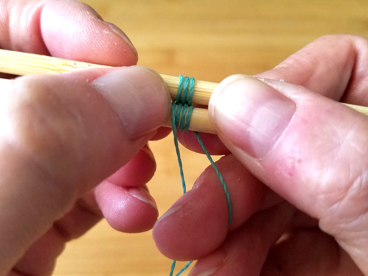 Compressing the weave regularly is an important step toward achieving a neat and tidy weave. Here, I'm compressing the weave by gently nudging the wraps together with my thumb nail