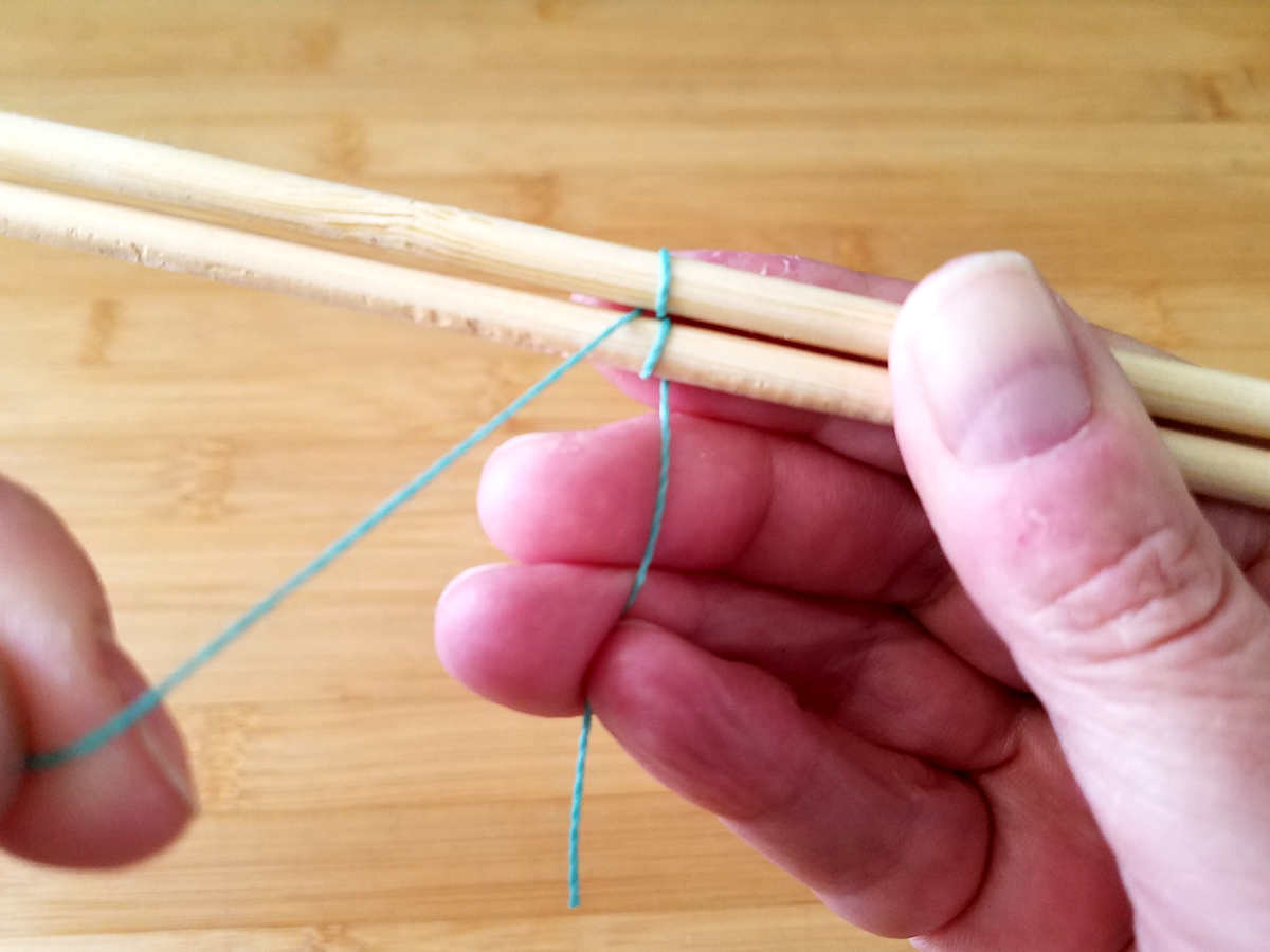 The first Figure 8 pattern repeat is complete when the weaving wire comes out between the two core wires and there is a single wrap on both wires, as shown in this image.