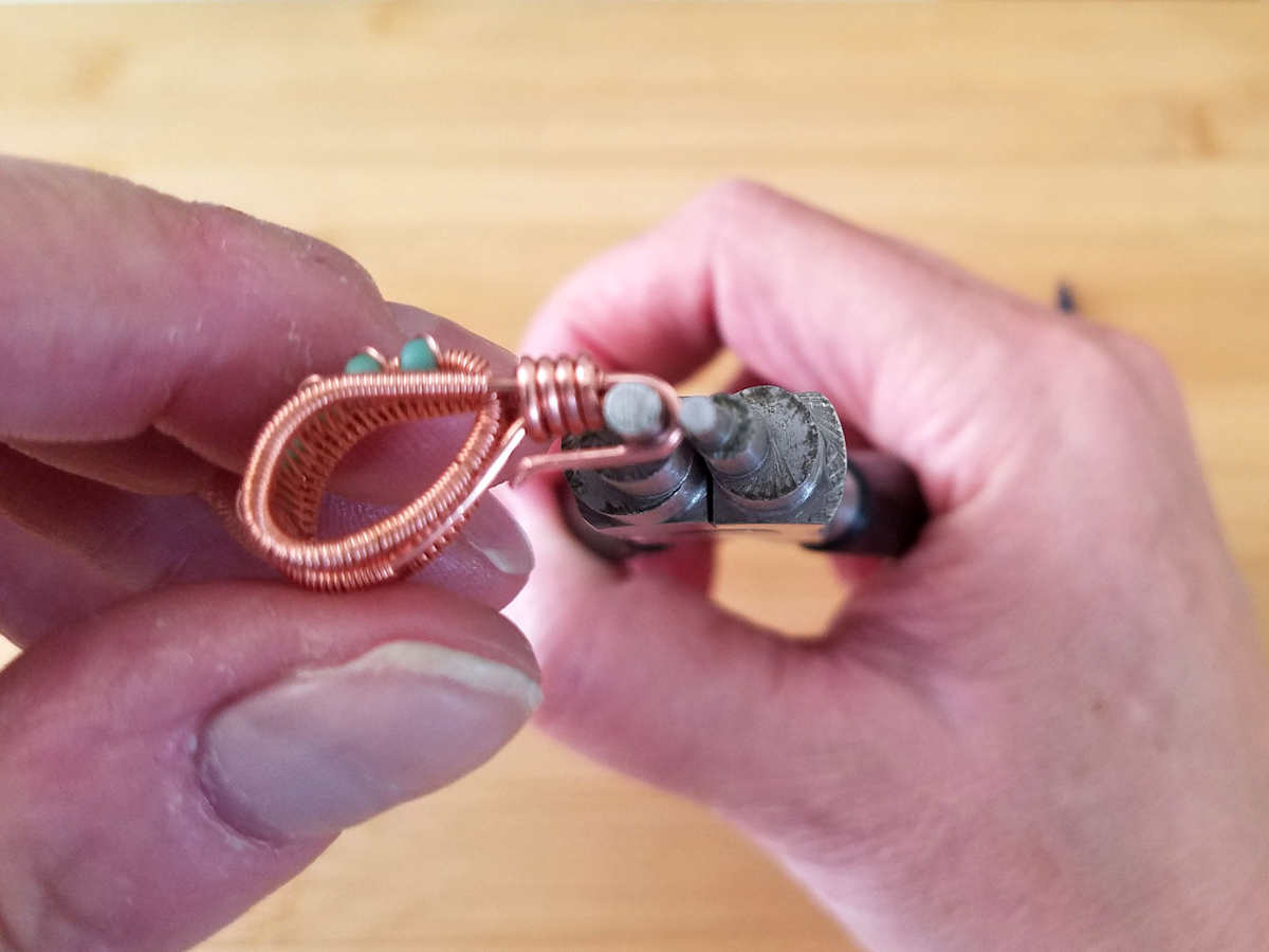 This image shows the author making the final bend on the pendant hoook.