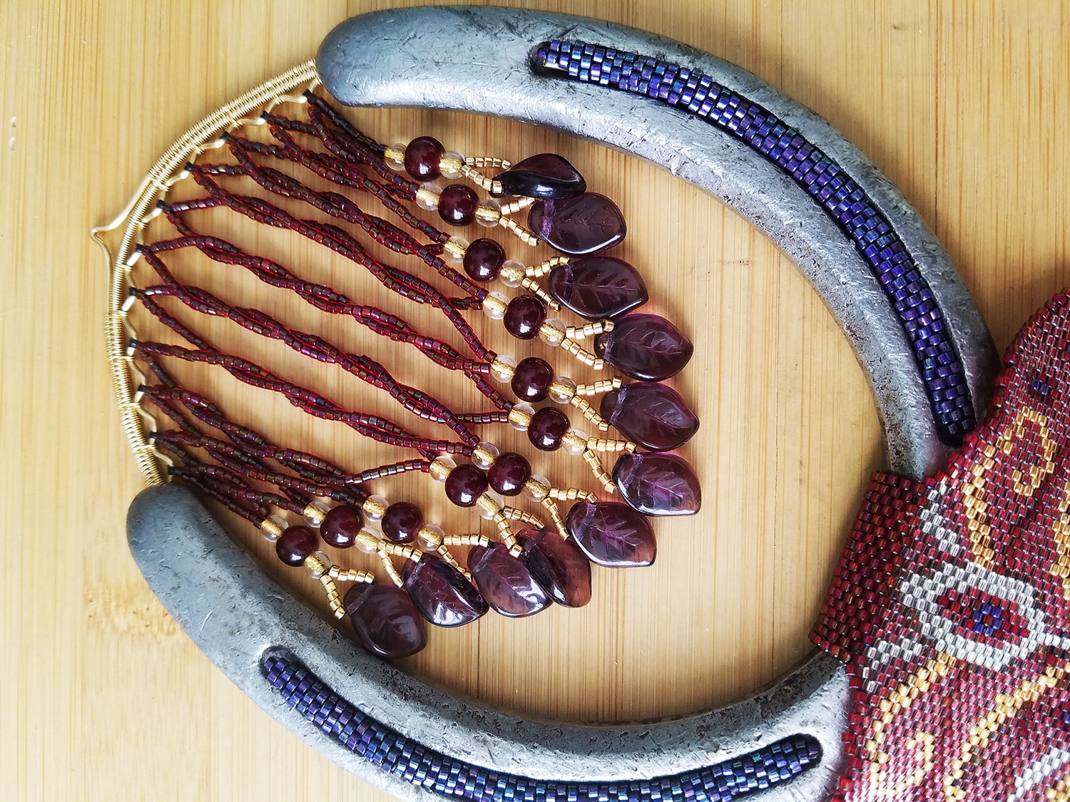 Detail of the wire woven horseshoe hanger with beaded fringe